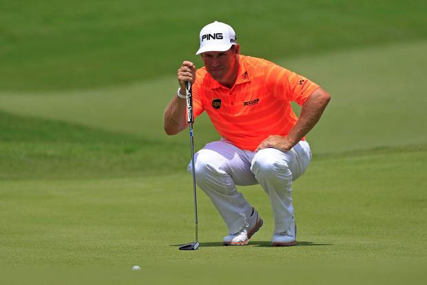 Lee Westwood of England lines up his putt on the seventh green during the third round of the Malaysian Open golf tournament in Kuala Lumpur, Malaysia
