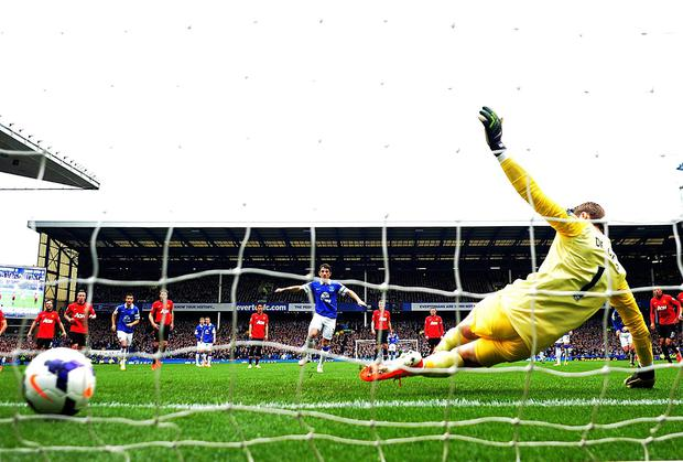 Everton's Leighton Baines fires his first-half penalty past Manchester United goalkeeper David De Gea