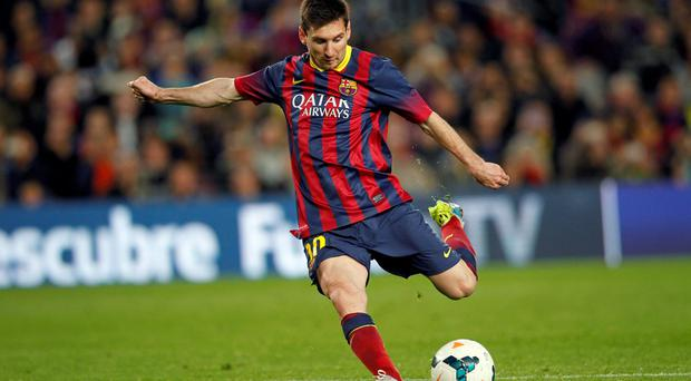 Barcelona's Lionel Messi kicks a fault before scoring a goal against Athletic Bilbao
