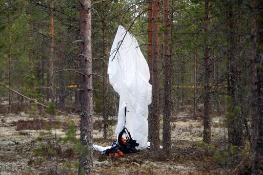 A parachute hangs from a tree close to the wreckage of experimental aircraft Comp Air 8 next to Jamijarvi Airfield, southwest Finland