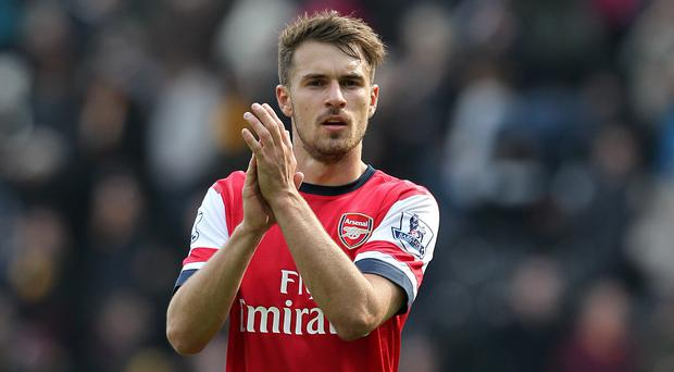 Arsenal's Aaron Ramsey applauds the fans after the the Barclays Premier League match at The KC Stadium