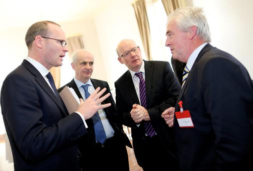 Minister for Agriculture Simon Coveney TD (left) with (L-R) Eddie Downey, IFA President, Pat Smith, IFA Gen Sec and Michael Biggins, IFA. Photo: Maxwells/Julien Behal