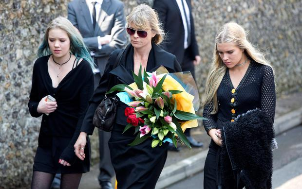 Former model Deborah Leng (C) arrives at the funeral service for Peaches Geldof at the St Mary Magdalene and St Lawrence church in Davington, southeast England