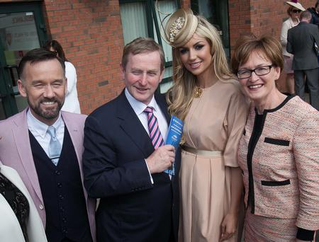 TV presenter Brendan Courtney, Taoiseach Enda Kenny, Rosanna Davison, and Fine Gael MEP Mairead McGuinnes during the Irish Grand National at Fairyhouse. Photo: Gareth Chaney Collins