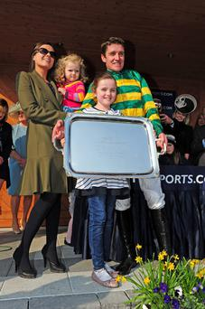 Jockey Barry Geraghty and family after he rode Shutthefrontdoor to victory in the Boylesports Irish Grand National Steeplechase