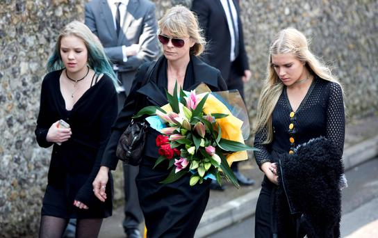 Lola Taylor, Debbie Leng and Tiger Lily Taylor arrive for the funeral of Peaches Geldof. Photo: Reuters