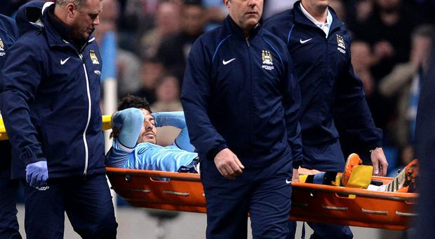 Manchester City's David Silva is carried off on a stretcher