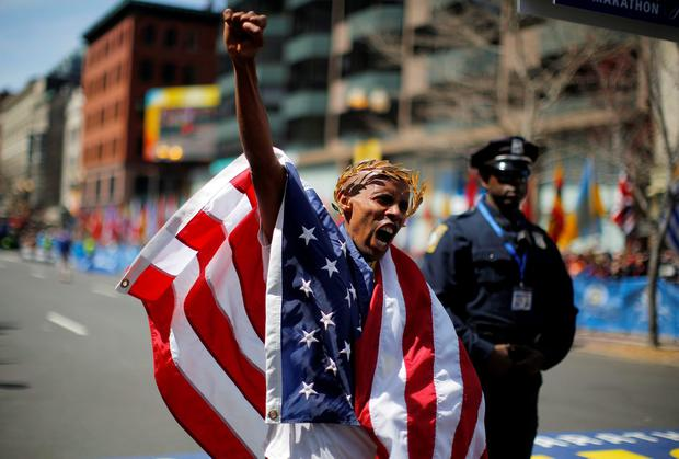 Meb Keflezighi of the U.S. reacts after winning the men's division of the 118th running of the Boston Marathon. Keflezighi became the first U.S. male athlete to win the Boston Marathon in three decades, an emotional performance in a city still recovering from last year's fatal bombing attack on the world-renowned race