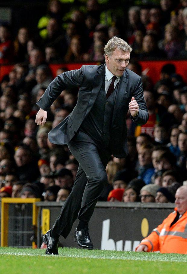 Then Manchester United manager David Moyes running along the touchline.