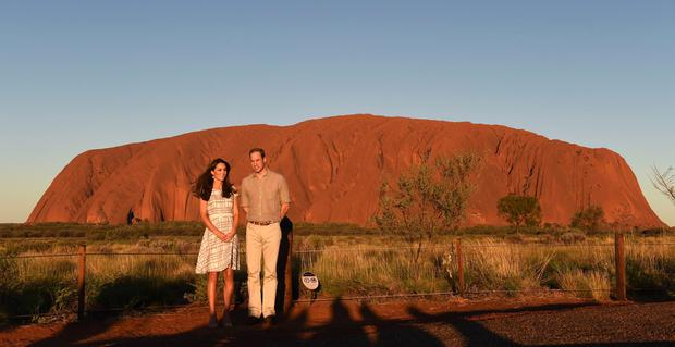 Britain's Prince William and Kate stand in front of the Uluru in the Northern Territory