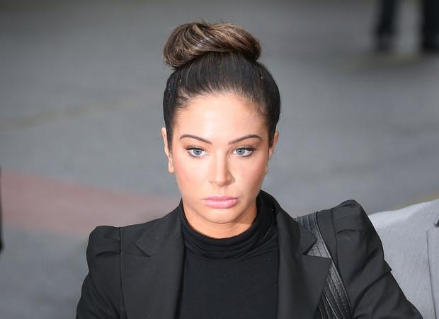LONDON, ENGLAND - APRIL 22: Tulisa Contostavlos arrives at Southwark Crown Court on April 22, 2014 in London, England. Ms Contostavlos faces a charge of supplying a class A drug. (Photo by Peter Macdiarmid/Getty Images)