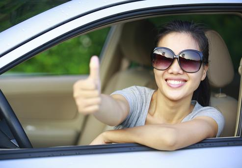 happy woman driver thumb up