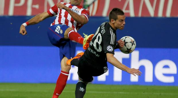Atletico Madrid's Diego Costa (L) challenges Chelsea's Cesar Azpilicueta during their Champions League semi-final first leg soccer match at Vicente Calderon stadium