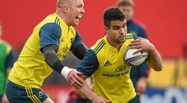 Munster's Conor Murray in action against Paul O'Connell during squad training ahead of their Heineken Cup semi-final against Toulon on Sunday