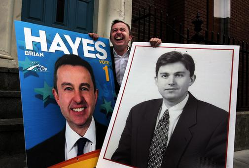Junior Minister Brian Hayes, the Fine Gael Dublin candidate in the European elections, holds up one of his posters (left), and a poster of himself as a 24-year-old when he contested the May 1994 Dublin South-Central by-election, at the launch of the party's poster campaign in Dubin. Photo: Tom Burke