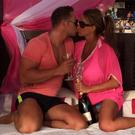 The couple smooch on the sun-bed (Photo: Twitter/Katie Price)