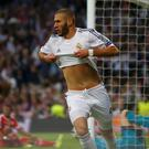 Real Madrid's Karim Benzema celebrates after scoring a goal against Bayern Munich during their Champion's League semi-final first leg