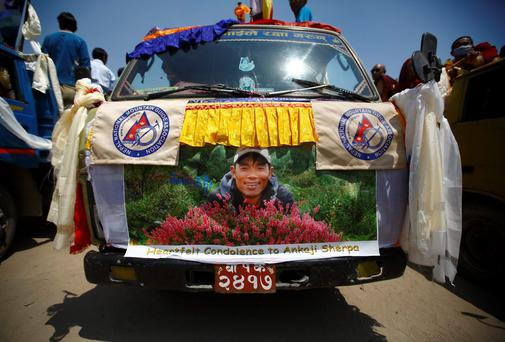A portrait of Ankaji Sherpa, who lost his life in an avalanche in Mount Everest last Friday, is seen on a truck carrying his body during a funeral rally of Nepali Sherpa climbers in Kathmandu