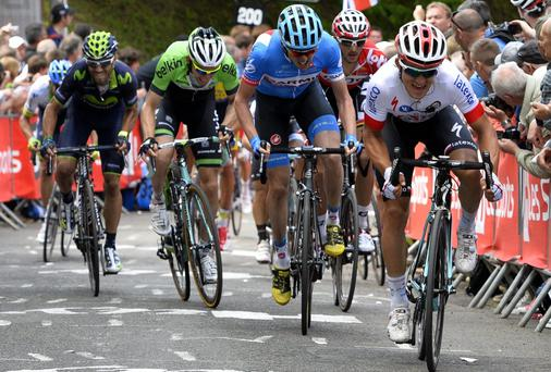 Ireland's Dan Martin (in blue) of Team Garmin-Sharp sprints for the finish line of the La Fleche Wallonne in Belgium yesterday. Photo: ERIC LALMAND/AFP/Getty Images
