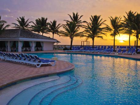 The pool at sunset at The Coconut Bay Resort
