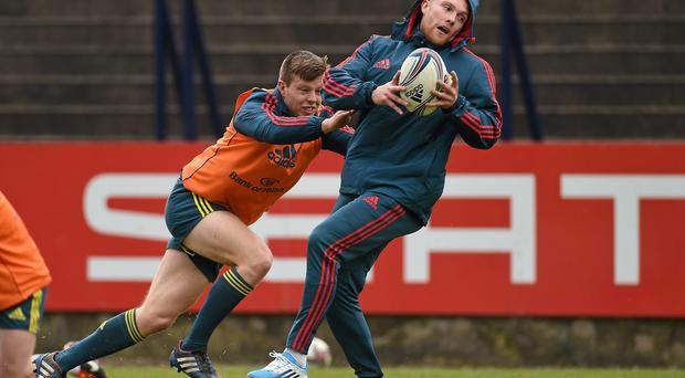 Munster's Keith Earls in action against Jonathan Holland during training ahead of their Heineken Cup semi-final against Toulon on Sunday. Photo: Diarmuid Greene / SPORTSFILE