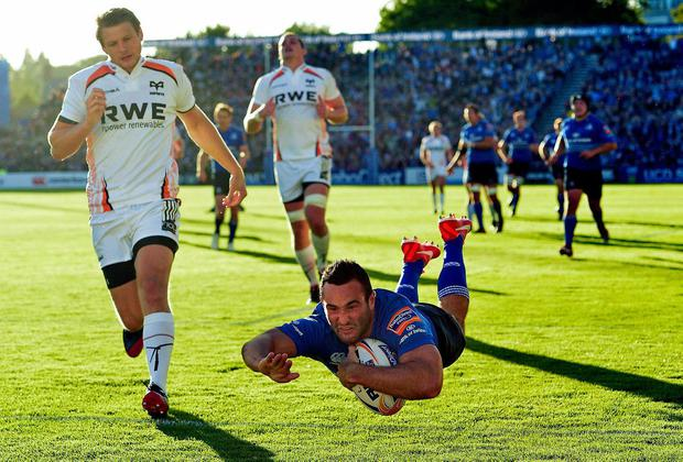 Dave Kearney dives over to score Leinster's second try against Ospreys