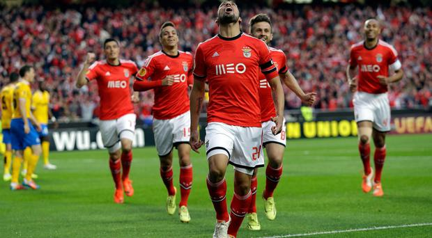 Benfica's Ezequiel Garay celebrates after scoring the opening goal during the Europa League semifinal first leg against Juventus.