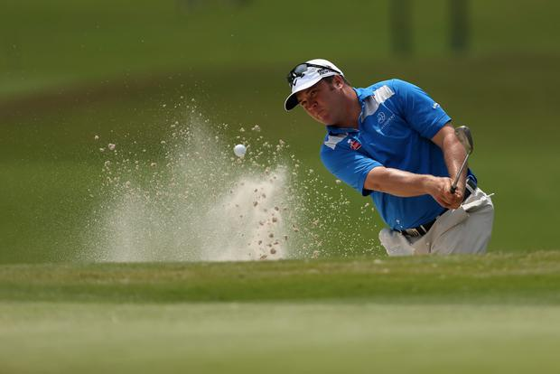 Andrew Svoboda chips out of the bunker on the 18th during Round One of the Zurich Classic of New Orleans at TPC Louisiana on April 24, 2014 in Avondale, Louisiana. Photo: Chris Graythen/Getty Images