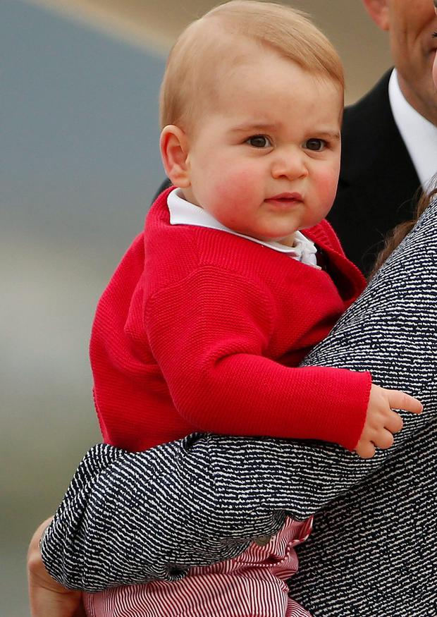 Kate Middleton holds her son Prince George