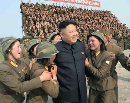 North Korean leader Kim Jong Un is seen as he guides the multiple-rocket launching drill of women's sub-units under KPA Unit 851, in this undated photo released by North Korea's Korean Central News Agency (KCNA) April 24, 2014. REUTERS/KCNA (NORTH KOREA