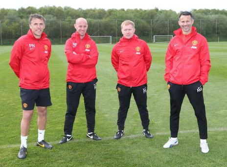A photo of Manchester United's management team of Phil Neville, Nicky Butt, Paul Scholes and Ryan Giggs