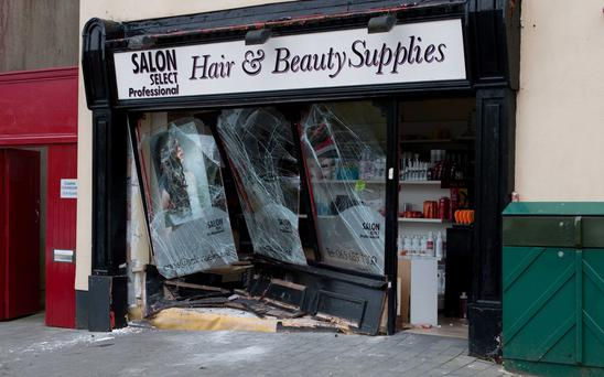 The damaged shop in Ennis when a car ploughed into the front. Picture: Press 22