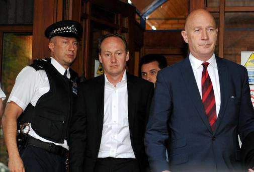 Gary Clarence (centre) leaves Wimbledon Magistrates Court, south west London, where his wife Tania appeared in court charged with murdering three of their children