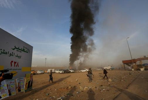 Iraqi security forces secure the scene of a car bomb attack during a Shi'ite political organisation's rally in Baghdad