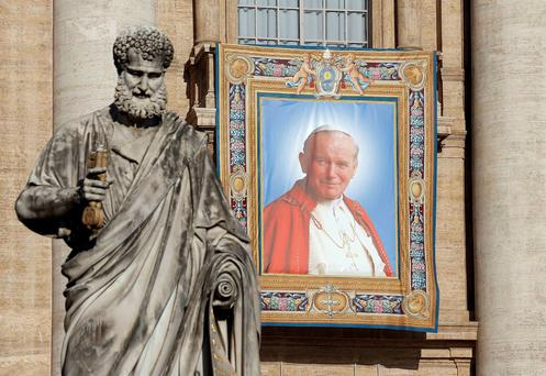 A tapestry featuring Pope John Paul II in St Peter's Square at the Vatican yesterday