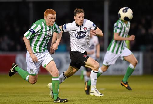 Dundalk's David McMillan and Bray Wanderers' Adam Mitchell battle it out at the Carlisle Grounds