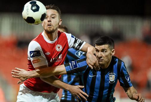 St Patrick's Athletic's Ger O'Brien and Athlone Town's Jason Marks battle for the ball