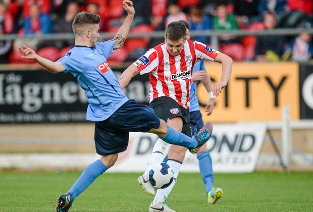 Derry City's Patrick McEleney is tackled by UCD's Colm Crowe