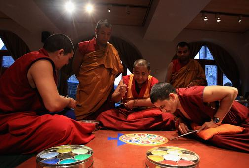 Tibetan monks creating a Sand Mandala as part of a Tantric Buddhist ritual in Glasgow in 2011