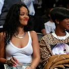 Rihanna sits court side at the game between the Brooklyn Nets and the Toronto Raptors yesterday