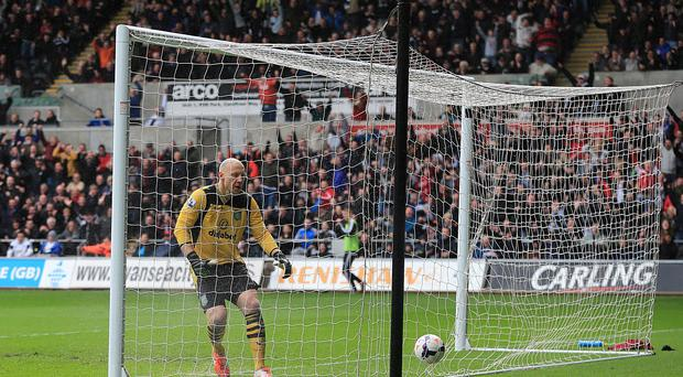Aston Villa's goalkeeper Bradley Guzan reacts after Swansea City's Jonjo Shelvey scores from the centre-circle.