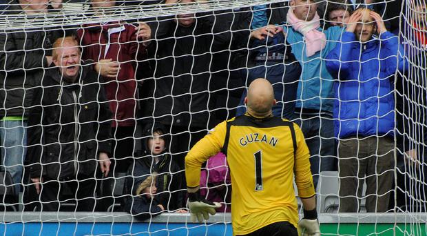 Aston Villa's goalkeeper Brad Guzan is beaten by a shot from Swansea City's Jonjo Shelvey at the Liberty Stadium.