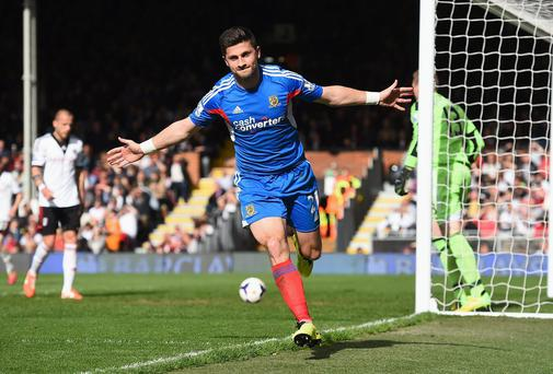 Hull's Shane Long celebrates after equalising against Fulham at Craven Cottage
