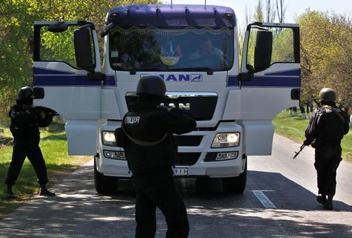 Ukrainian government troops inspect a truck in the east of the country