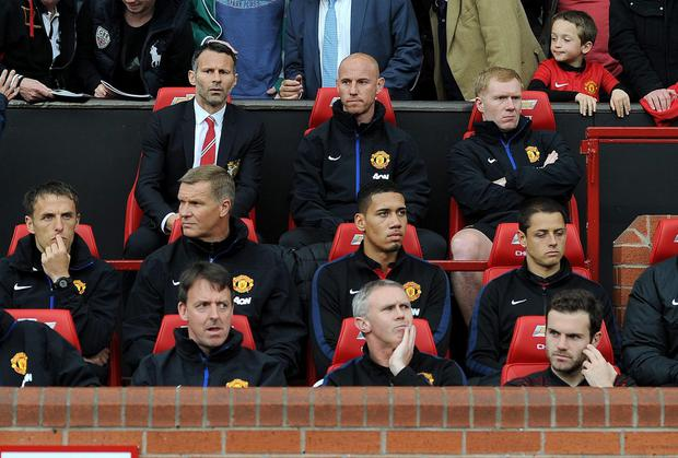 Ryan Giggs in the Old Trafford dug out last night, with others from the Class of '92, Phil Neville, Nicky Butt and Paul Scholes. Photo: Martin Rickett/PA Wire