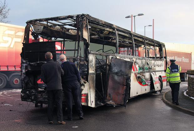 A bus abandoned and set on fire outside a Quinn factory in Cavan. Photo: Lorraine Teevan