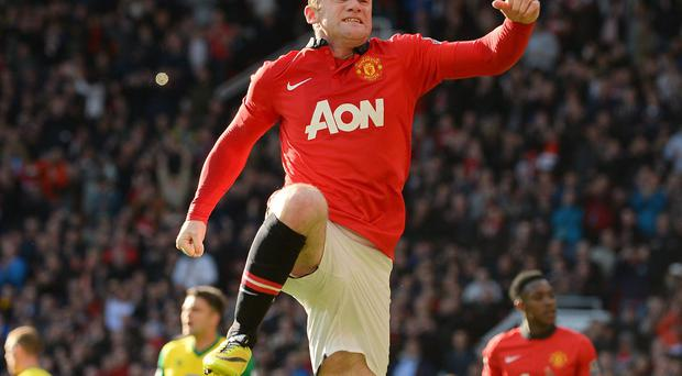 Wayne Rooney celebrates after scoring from the penalty spot to put Manchester United ahead against Norwich City at Old Trafford. Photo: ANDREW YATES/AFP/Getty Images