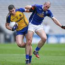 Roscommon's Cathal Shine and Cavan's Killian Brady battle for the ball