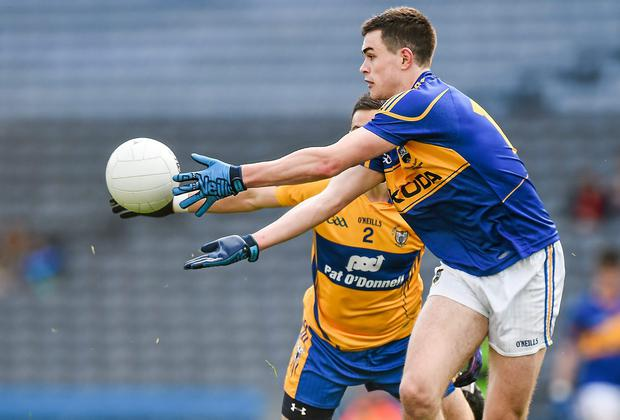 Tipperary's Conor Sweeney in action against Clare's Dean Ryan