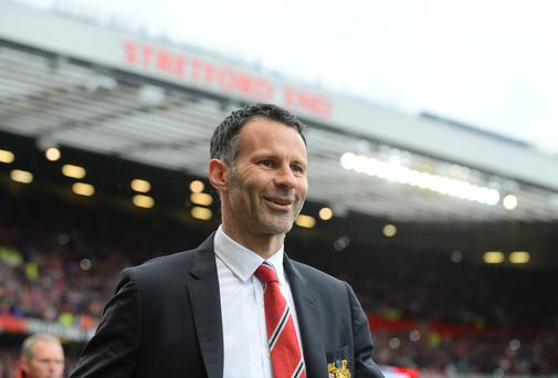 Ryan Giggs makes his way out at Old Trafford under the shadow of the Stretford End for his first game in charge of the club he has spent his entire playing career with. Photo: ANDREW YATES/AFP/Getty Images